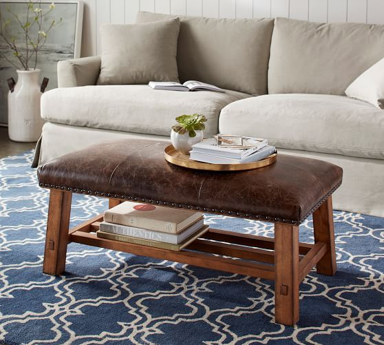 Ottomans over the coffee table as living room decoration